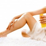 Woman applying cream for waxing preparation and after care